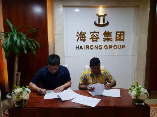 Mr. Bandula Vithanarachchi signing agreements with Hairong Investment Group Co., Ltd